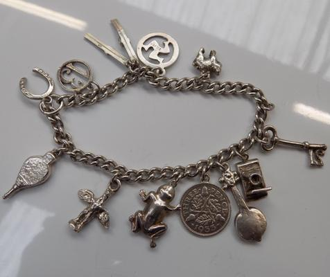 Heavy silver charm bracelet with charms
