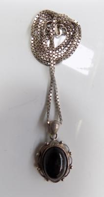Silver pendant on silver chain