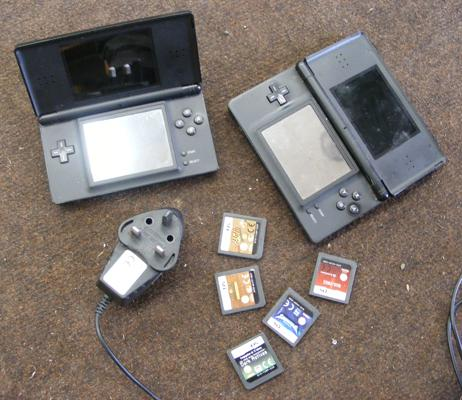 2x DS games consoles W/O , charger and games