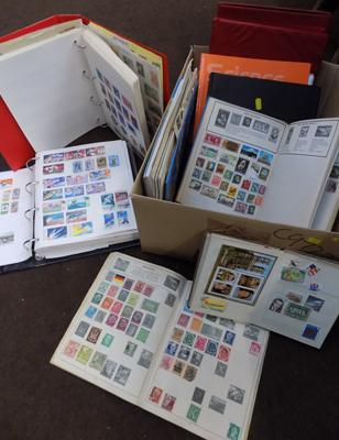 Large selection of world stamp albums and folders (9)