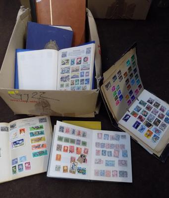 Large assortment of world stamp albums (9)