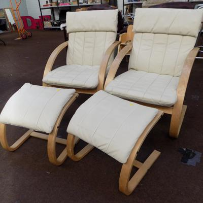 Pair of cream leather chairs with footstool
