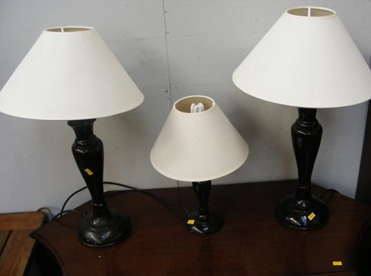 Three black table lamps with shades