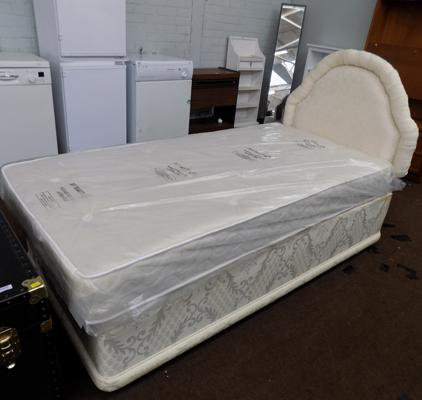 Single bed with new/unused mattress
