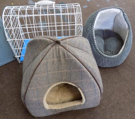 Two cat igloos and a cat carrier