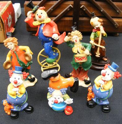 Collection of 7 model clowns