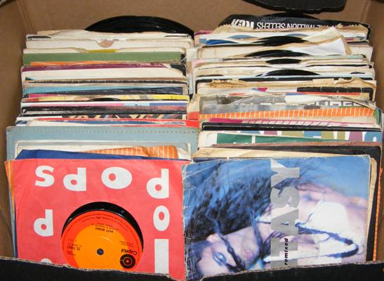 Box of over 140 7 inch singles