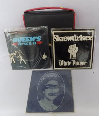 Selection of 7 inch singles, incl. Sex Pistols, Skrewdriver & Queen with case
