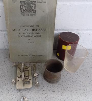 Collection of vintage medical items in box, medicine measures, glass syringe etc