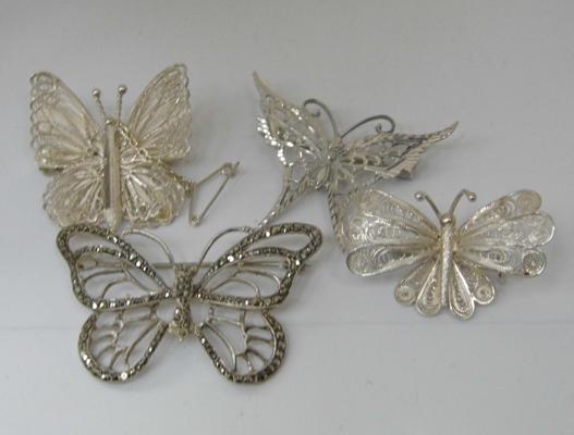 4 sterling silver butterfly brooches, 2 filigree, 1 marcasite & 1 diamond cut