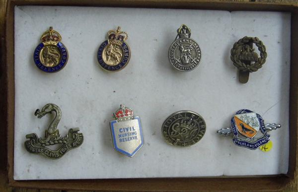 Collection of silver & white metal + metal & enamel badges/button hole badges