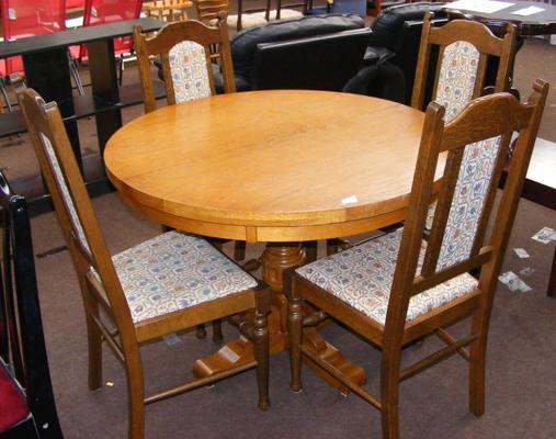 Circular oak table and four chairs