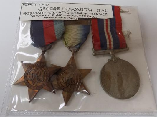 Trio of WWII medals, George Howarth RN 1939 Star, Atlantic Star + France/Germany war medal