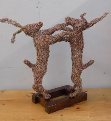 Sculpture of fighting hares, 60cm tall