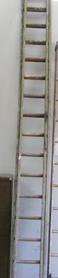 Set of double wooden ladders
