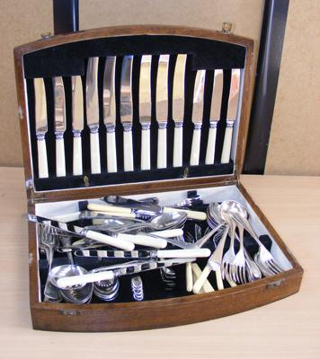 Selection of cutlery in wooden case