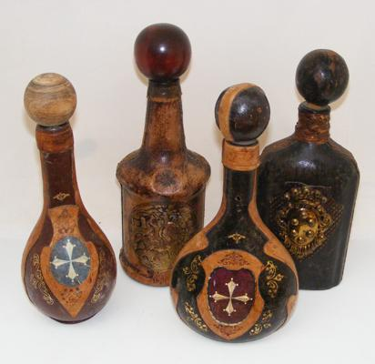 Selection of 4 leather covered bottles