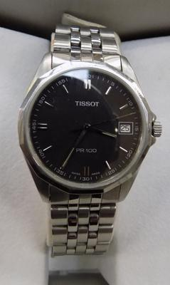 Gents Tissot press watch with spare links and paperwork