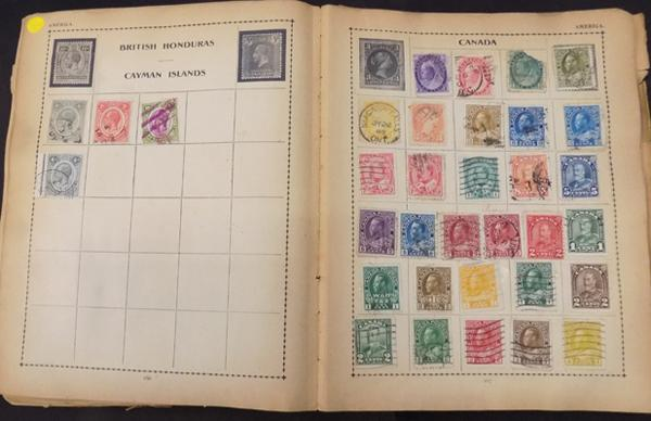 Tatty album containing good range of early World stamps