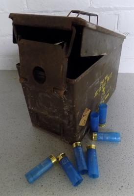 Metal ammo box with ammo shells
