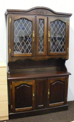 Leaded glass fronted oak display cabinet