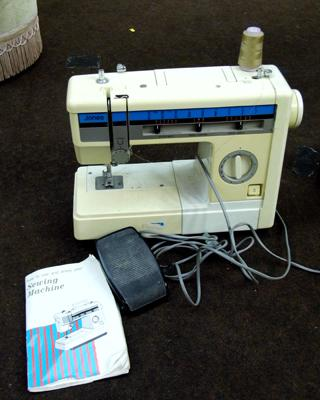 Jones electric sewing machine with instruction book
