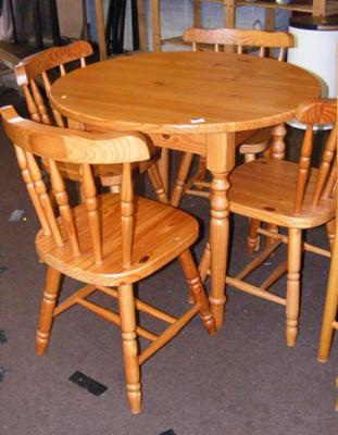 Small pine circular table and four chairs