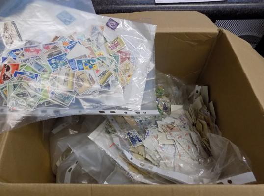 Vast quantity of World stamps - sorted into packets