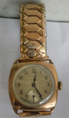 Gold gents vintage watch with rolled gold strap