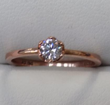 Ladies sterling silver ring covered in rose gold - size K 1/2