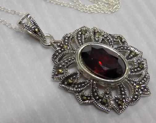 Silver Garnet and Marcasite pendant on silver chain