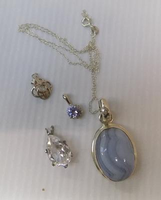 Silver pendant on chain and 3 silver pendants