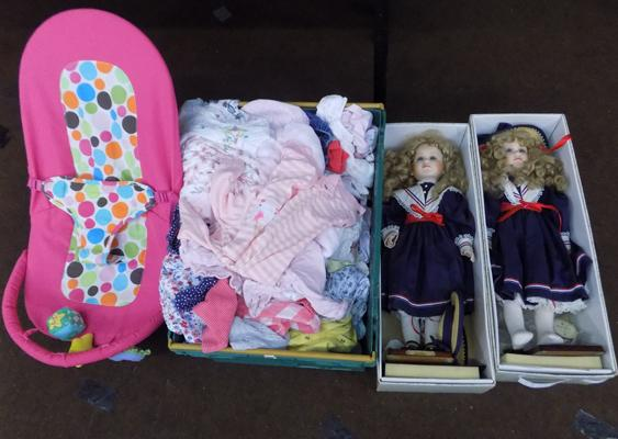 Baby bouncer + box of baby girls clothes and 2 dolls