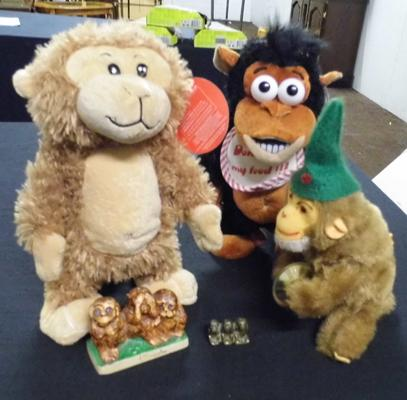 Selection of five toy and ornamental monkeys