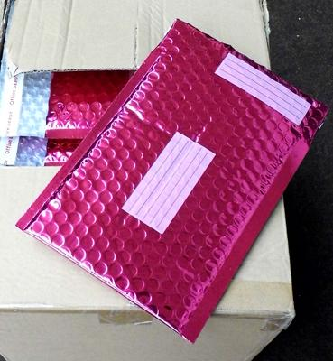 Box of pink metallic padded envelopes 7x9 inches approx