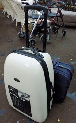 Plastic luggage case on wheels + another suitcase