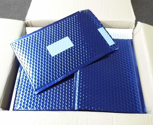 Box of dark blue padded envelopes 13x10 inches approx
