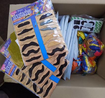 Box of 600 party balloons, moustaches etc