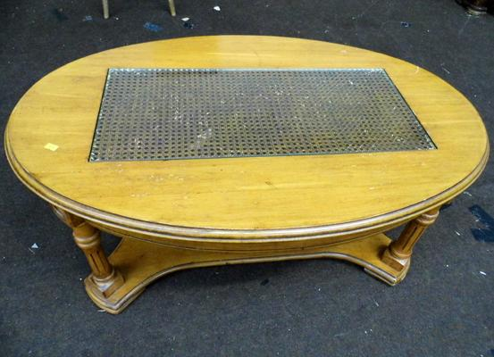 Glass topped oval coffee table 16 inches tall
