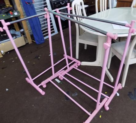 3x Pink clothes stands