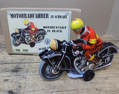 Tin plate friction motorcyclist