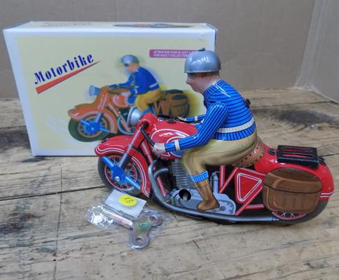 Red solo motorbike, wind-up tinplate