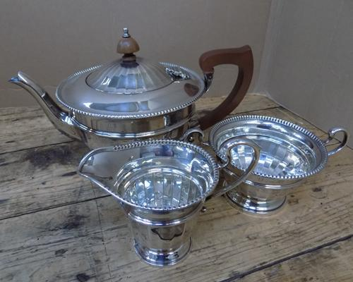 Silver 3 piece tea service, Collingwood & Sons, Birmingham 1935, circular with beaded border - total weight 607.4 grams
