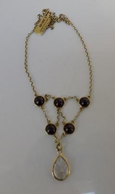 9ct Gold chain with 5 garnets 10.1gms & white stone