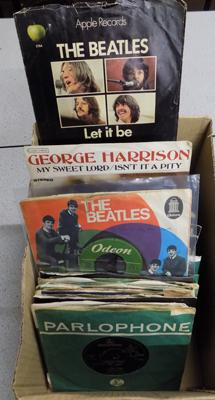 Box of first press Beatles singles - 100 in total