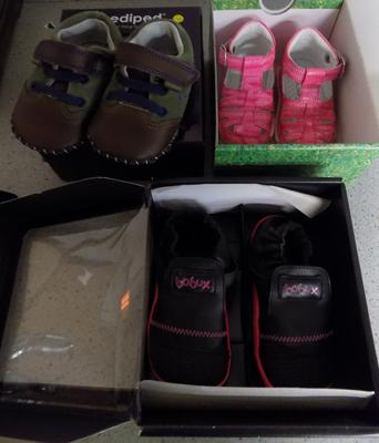 Three pairs of children's shoes, boxed as new