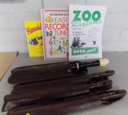 Collection of recorders & music books