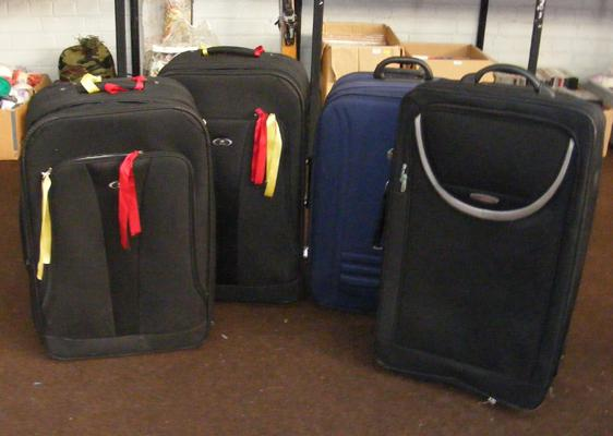 Four travel suitcases