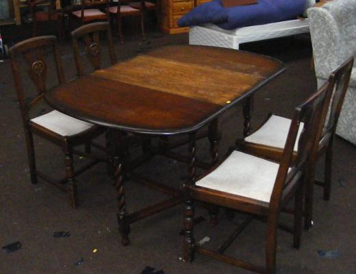 Drop leaf table and four chairs