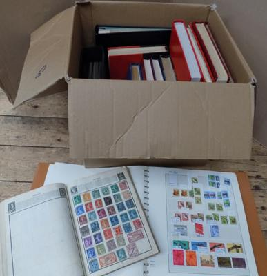 Box containing 14 stamp albums